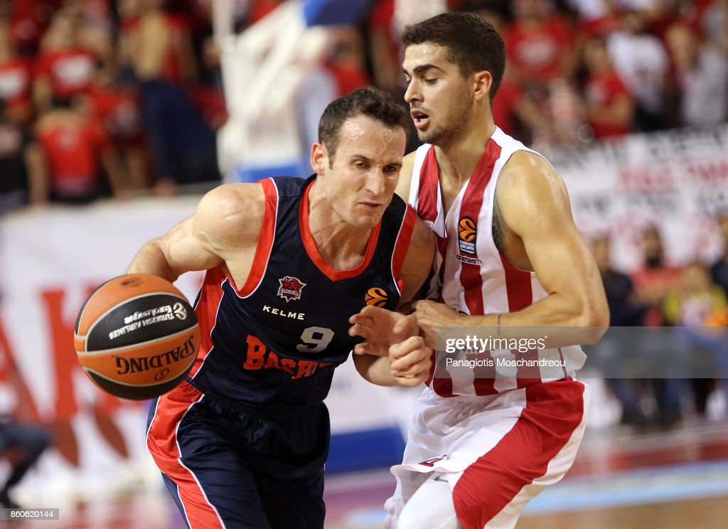 Marcelinho Huertas, #9 of Baskonia Vitoria Gasteiz competes with Vassilis Toliopoulos, #4 of Olympiacos Piraeus during the 2017/2018 Turkish Airlines EuroLeague Regular Season Round 1 game between Olympiacos Piraeus v Baskonia Vitoria Gasteiz at Heraklion Arena on October 12, 2017 in Heraklion, Crete, Greece.