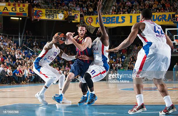 Marcelinho Huertas #9 of FC Barcelona competes with Sonny Weems #13 of CSKA Moscow and Jeremy Pargo #11 during the 20132014 Turkish Airlines...
