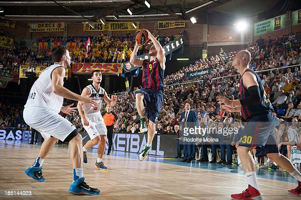 Marcelinho Huertas #9 of FC Barcelona in action during the 20132014 Turkish Airlines Euroleague Regular Season date 1 game between FC Barcelona Regal...