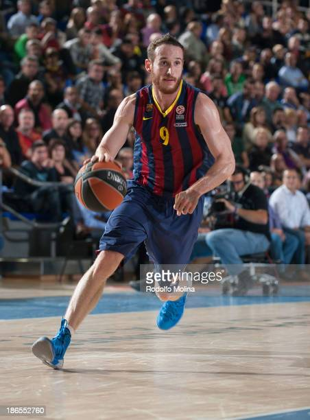 Marcelinho Huertas #9 of FC Barcelona in action during the 20132014 Turkish Airlines Euroleague Regular Season Date 3 game between FC Barcelona Regal...