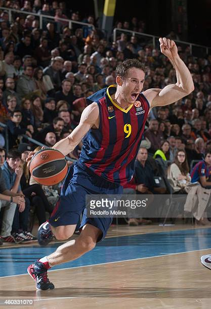 Marcelinho Huertas #9 of FC Barcelona in action during the 20142015 Turkish Airlines Euroleague Basketball Regular Season Date 9 game between FC...