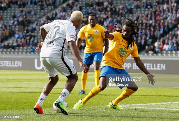 Marcelinho is challenged by Tinga during the Marcelinho testimonial match between a team of former Hertha BSC players and a team of brasilian players...