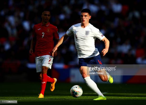 Marcelinho of Bulgaria looks on as Declan Rice of England controls the ball during the UEFA Euro 2020 qualifier match between England and Bulgaria at...