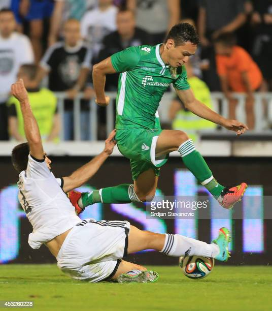 Marcelinho of FC Ludogorets Razgrad in action against Miroslav Vulicevic of FC Partizan Belgrade during the UEFA Champions League third qualifying...