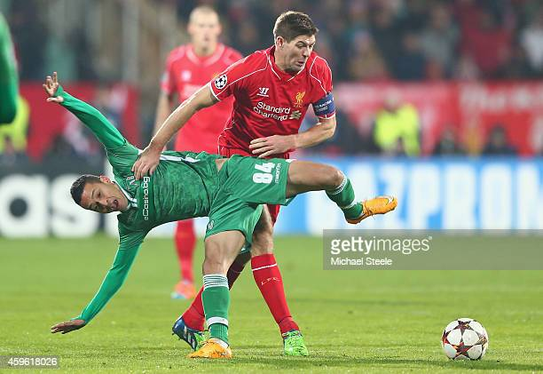 Marcelinho of Ludogerets loses out to Steven Gerrard of Liverpool during the UEFA Champions League Group B match between Ludogorets Razgrad and...