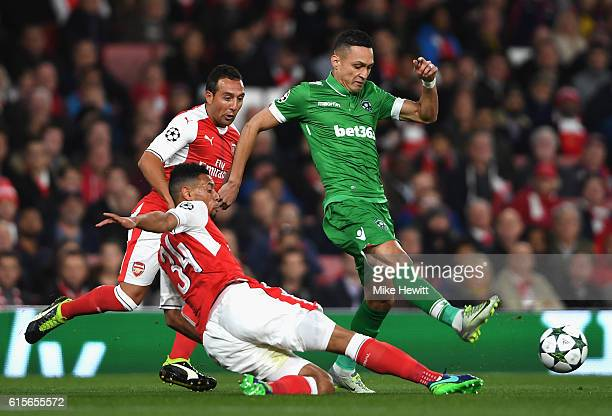Marcelinho of Ludogorets Razgrad is tackled by Francis Coquelin of Arsneal during the UEFA Champions League group A match between Arsenal FC and PFC...