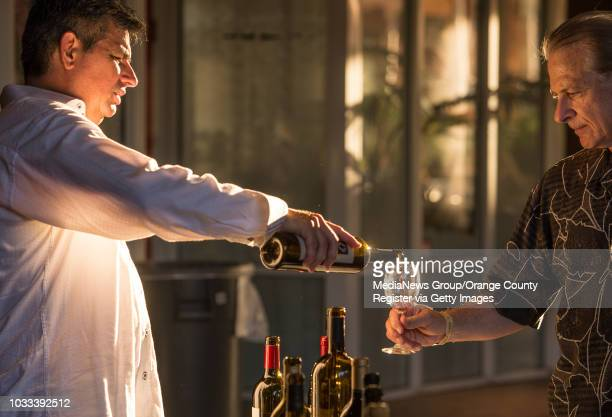 Marcelino Cosio left of the Estates Group Youngs Market pours Stan Rosenblatt of Aliso Viejo a glass of wine during the 4th Annual Kaleidoscope Wines...