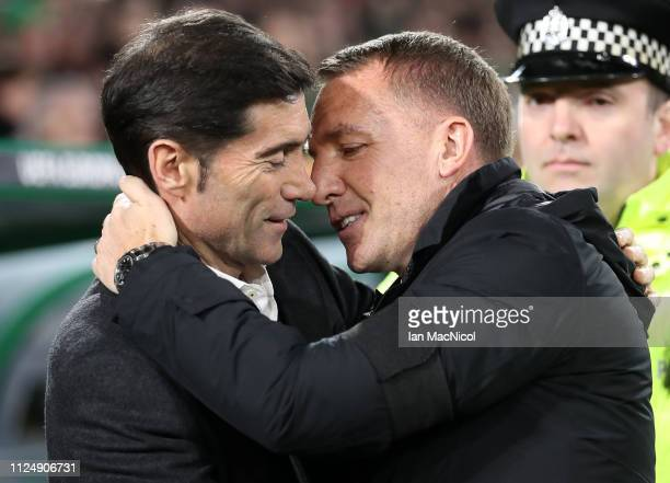 Marcelino Garcia Toral of Valencia is embraces by Brendan Rodgers Manager of Celtic ahead of the UEFA Europa League Round of 32 First Leg match...