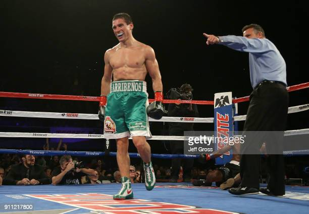 Marcelino Lopez of Argentina is ordered back to his corner after knocking down Breidis Prescott of Colombia during their welterweight bout at The...