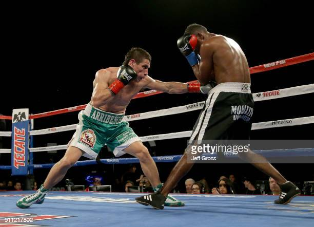 Marcelino Lopez of Argentina lands a left hand to the body of Breidis Prescott of Colombia during their welterweight bout at The Forum on January 27...