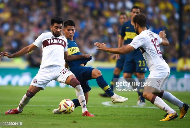 Marcelino Moreno of Lanus fights for the ball with Jorman Campuzano of Boca Juniors during a match between Boca Juniors and Lanus as part of...