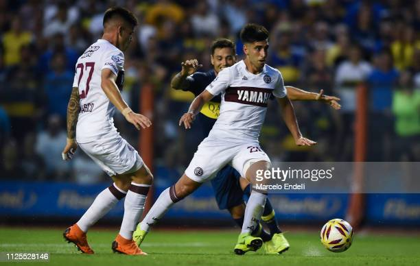 Marcelino Moreno of Lanus kicks the ball during a match between Boca Juniors and Lanus as part of Superliga 2018/19 at Estadio Alberto J Armando on...