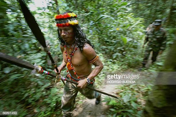 Marcelino Uyuncar an indigenous instructor from the Huaorani ethnics teaches survival techniques to the troops during their training at the Jungle...