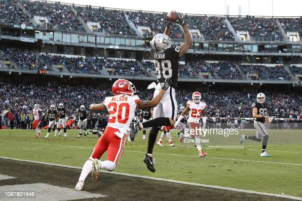 Marcell Ateman of the Oakland Raiders catches a nine-yard touchdown against the Kansas City Chiefs during their NFL game at Oakland-Alameda County...