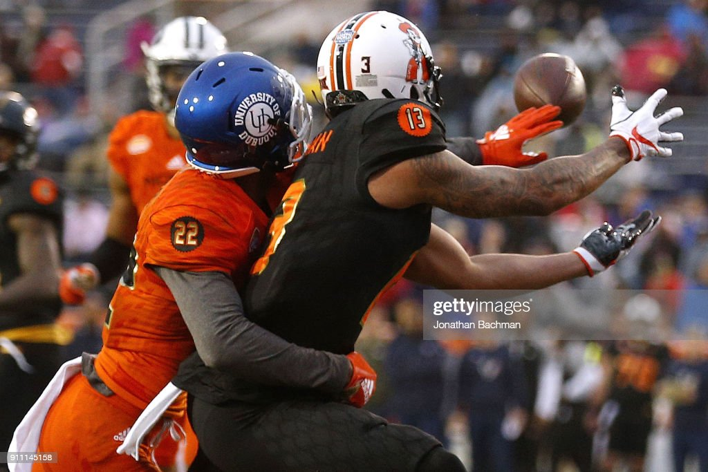 Marcell Ateman #13 of the South team catches the ball for a touchdown as Michael Joseph #22 of the North team defends during the second half of the Reese's Senior Bowl at Ladd-Peebles Stadium on January 27, 2018 in Mobile, Alabama.