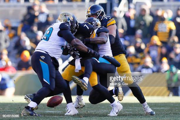 Marcell Dareus and Yannick Ngakoue of the Jacksonville Jaguars force Ben Roethlisberger of the Pittsburgh Steelers to fumble during the first half of...