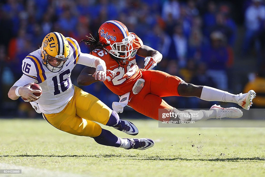 Marcell Harris #26 of the Florida Gators tackles Danny Etling #16 of the LSU Tigers during the second half of a game at Tiger Stadium on November 19, 2016 in Baton Rouge, Louisiana.