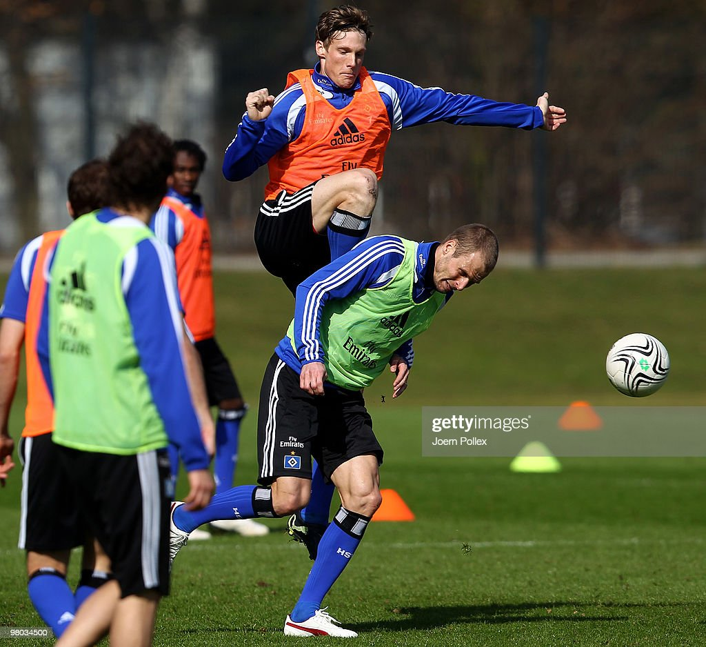 Marcell Jansen and David Rozehnal of Hamburg compete for the ball during the Hamburger SV training session at the HSH Nordbank Arena on March 25, 2010 in Hamburg, Germany.