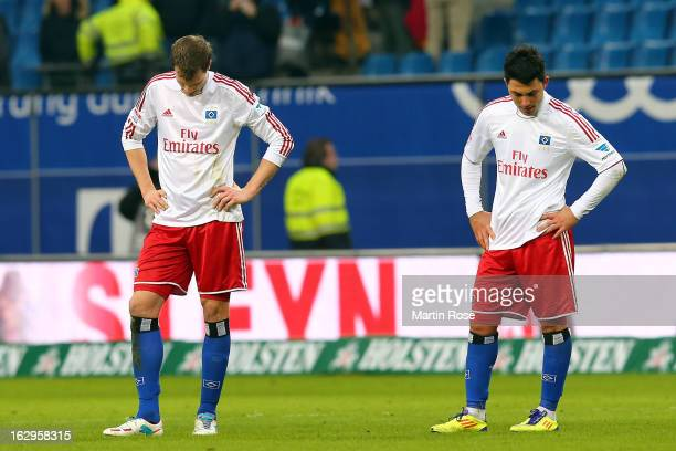 Marcell Jansen and Tolgay Arslan of Hamburger SV look dejected after the Bundesliga match between Hamburger SV and Greuther Fuert at Imtech Arena on...