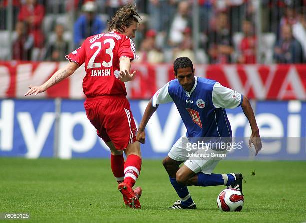 Marcell Jansen of Bayern and Dexter Langen of Rostock in action during the Bundesliga match between Bayern Munich and Hansa Rostock at the Allianz...