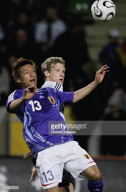 Marcell Jansen of Germany and Atsushi Yanagisawa of Japan go up for a header during the International Friendly match between Germany and Japan at the...