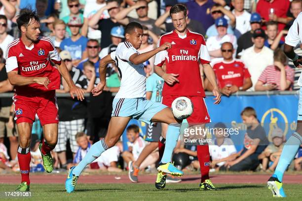 Marcell Jansen of Hamburg and Ravel Morrison of West Ham compete for the ball during the friendly match Hamburger SV and West Ham United at...