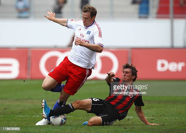 Marcell Jansen of Hamburg battles for the ball with Andreas Buchner of Ingolstadt during the preseason friendly match between Hamburger SV and FC...