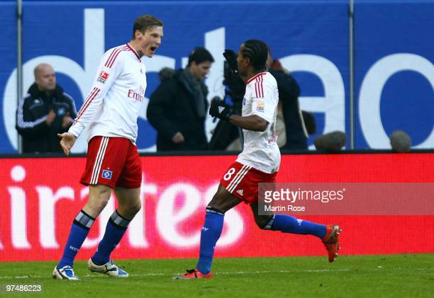 Marcell Jansen of Hamburg celebrates after he scores his team's opening goal during the Bundesliga match between Hamburger SV and Hertha BSC Berlin...