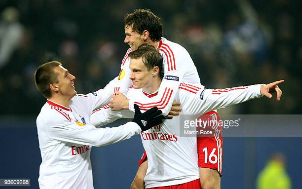 Marcell Jansen of Hamburg celebrates after scoring his team's first goal with team mates Robert Tesche and Marcus Berg during the UEFA Europa League...
