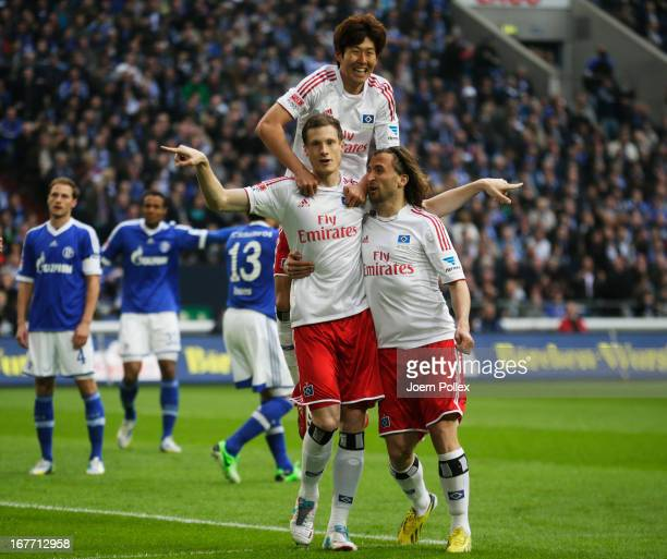 Marcell Jansen of Hamburg celebrates with his team mates after scoring his team's first goal during the Bundesliga match between FC Schalke 04 and...