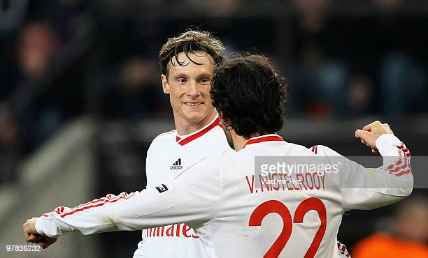 Marcell Jansen of Hamburg is celebrated by his team mate Ruud van Nistelrooy after scoring his team's second goal during the UEFA Europa League round...