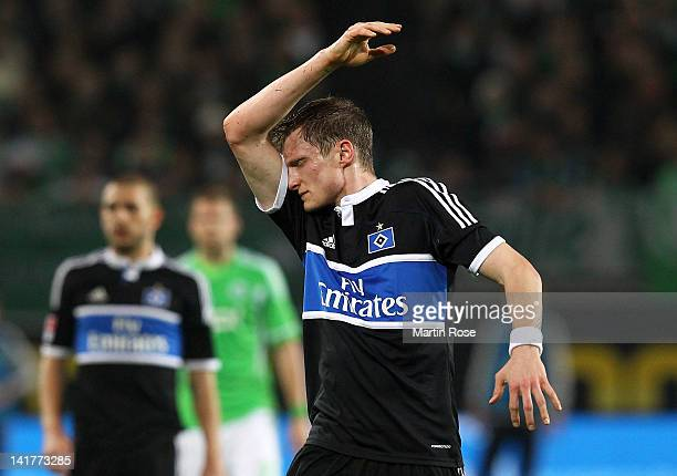Marcell Jansen of Hamburg reacts during the Bundesliga match between VfL Wolfsburg and Hamburger SV at the Volkswagen Arena on March 23, 2012 in...