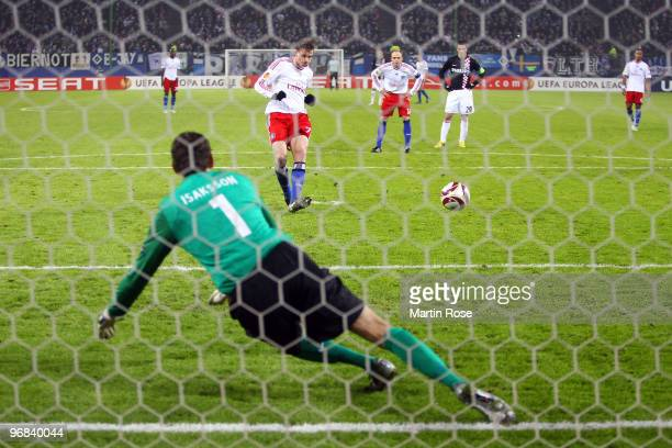 Marcell Jansen of Hamburg scores his team's first goal during the UEFA Europa League knockout round first leg match between Hamburger SV and PSV...