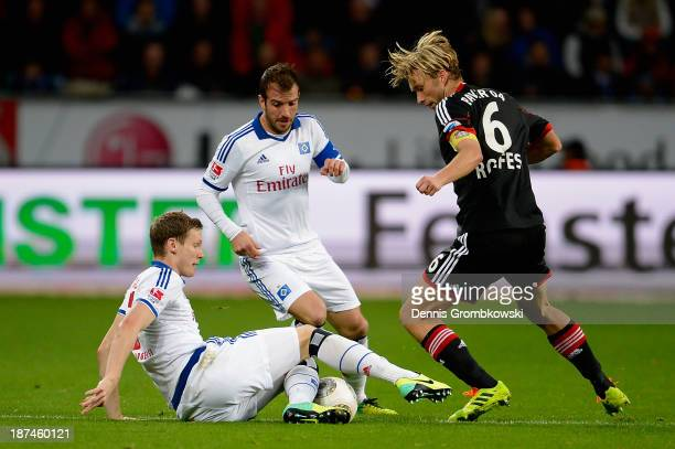 Marcell Jansen of Hamburger SV and Simon Rolfes of Bayer Leverkusen battle for the ball during the Bundesliga match between Bayer Leverkusen and...