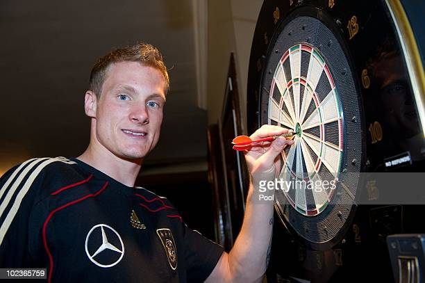 Marcell Jansen of the German National Team plays dart at Velmore Grande Hotel on June 20 2010 in Pretoria South Africa