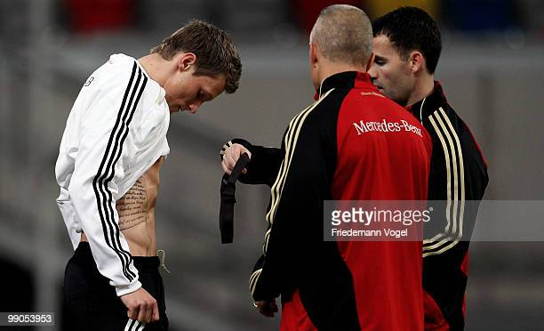Marcell Jansen puts on a pulse measure during a German National team training session at the Esprit Arena on May 12, 2010 in Dusseldorf, Germany.