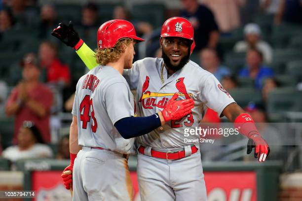 Marcell Ozuna celebrates scoring with Harrison Bader of the St Louis Cardinals during the eighth inning against the Atlanta Braves at SunTrust Park...