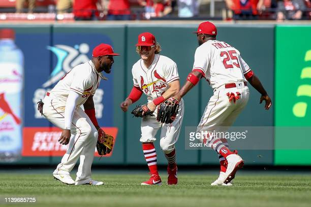 Marcell Ozuna Harrison Bader and Dexter Fowler of the St Louis Cardinals celebrate after the final out of the in the ninth inning against the...