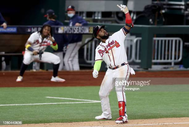 Marcell Ozuna of the Atlanta Braves celebrates after hitting a solo home run against the Los Angeles Dodgers during the seventh inning in Game Four...