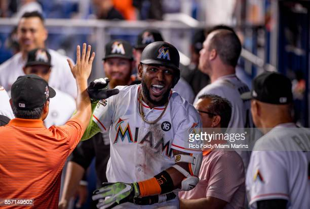 Marcell Ozuna of the Miami Marlins celebrates a home run during the seventh inning of the game against the Atlanta Braves at Marlins Park on October...