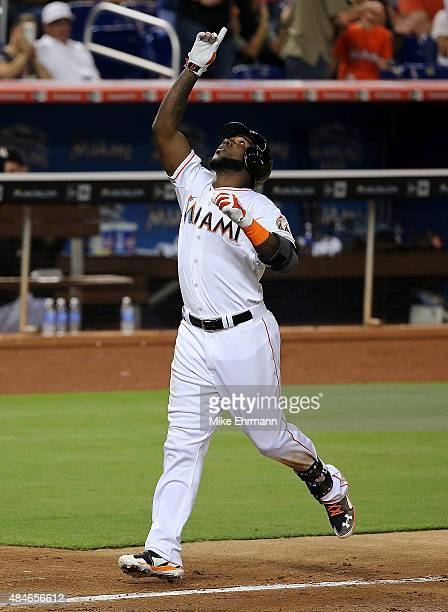Marcell Ozuna of the Miami Marlins celebrates after hitting a two run home run during a game at Marlins Park on August 20 2015 in Miami Florida