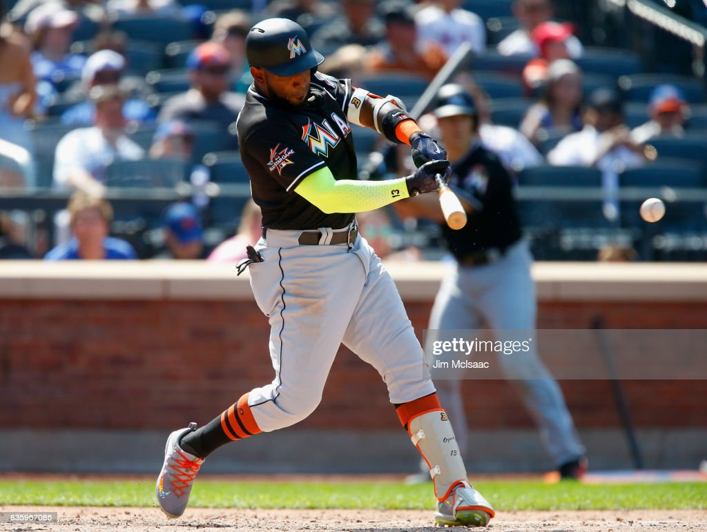 Marcell Ozuna #13 of the Miami Marlins connects on a seventh inning RBI single against the New York Mets at Citi Field on August 20, 2017 in the Flushing neighborhood of the Queens borough of New York City.