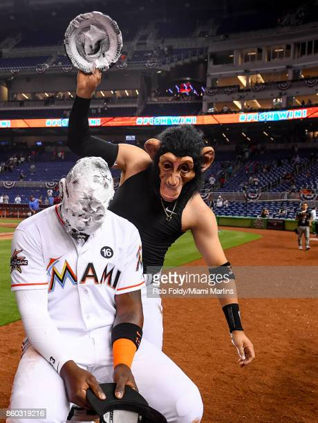 Marcell Ozuna of the Miami Marlins gets a shaving cream pie to the face after the Opening Day game against the Atlanta Braves at Marlins Park on...