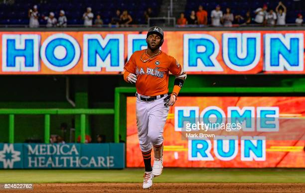 Marcell Ozuna of the Miami Marlins hits a three run homerun in the ninth inning during the game between the Miami Marlins and the Cincinnati Reds at...