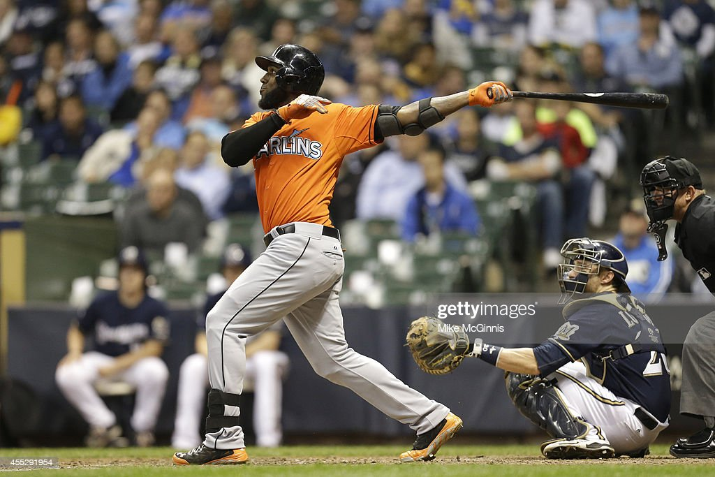 Marcell Ozuna #13 of the Miami Marlins hits a two-run homer in the top of the eighth inning against the Milwaukee Brewers at Miller Park on September 11, 2014 in Milwaukee, Wisconsin.