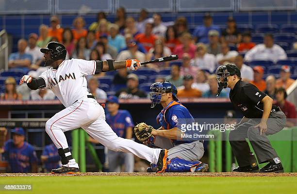 Marcell Ozuna of the Miami Marlins hits a walk off sacrafice fly during a game against the New York Mets at Marlins Park on May 7 2014 in Miami...
