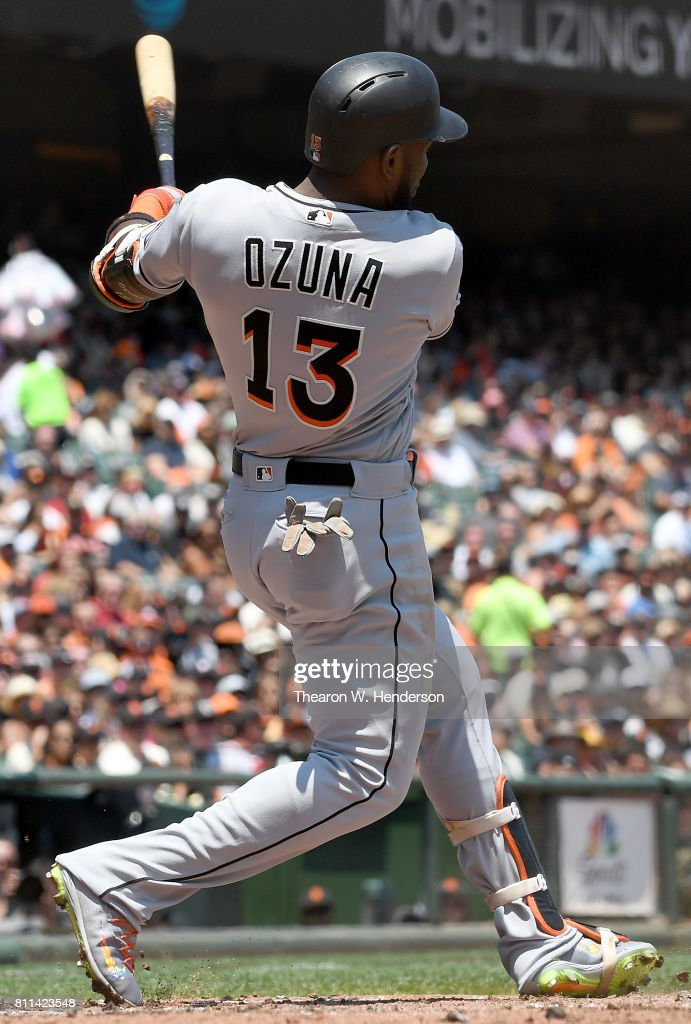 Marcell Ozuna #13 of the Miami Marlins hits an rbi double scoring Christian Yelich #21 against the San Francisco Giants in the top of the third inning at AT&T Park on July 9, 2017 in San Francisco, California.