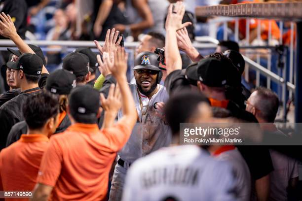 Marcell Ozuna of the Miami Marlins in the dugout during the game against the Atlanta Braves at Marlins Park on October 1 2017 in Miami Florida