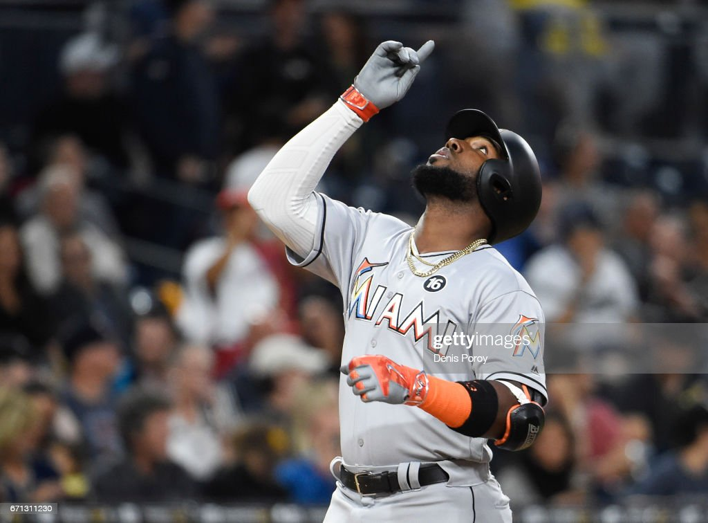 Marcell Ozuna #13 of the Miami Marlins points skyward after hitting a solo home run during the second inning of a baseball game against the San Diego Padres at PETCO Park on April 21, 2017 in San Diego, California.