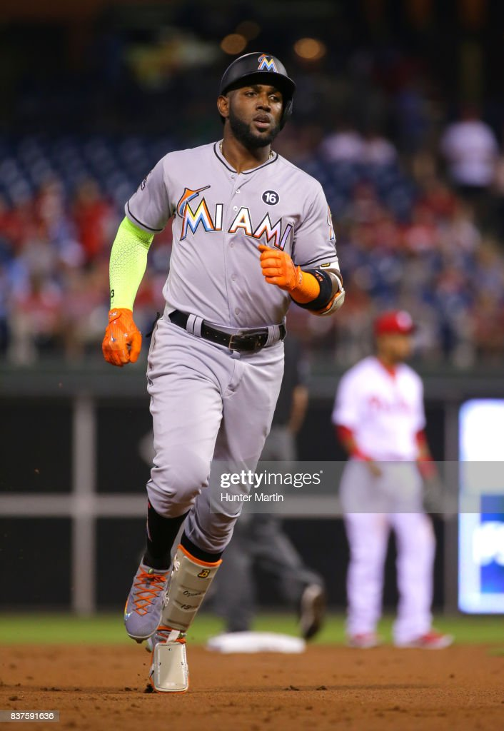 Marcell Ozuna #13 of the Miami Marlins rounds the bases after hitting a two-run home run in the first inning during game two of a doubleheader against the Philadelphia Phillies at Citizens Bank Park on August 22, 2017 in Philadelphia, Pennsylvania. The Marlins won 7-4.